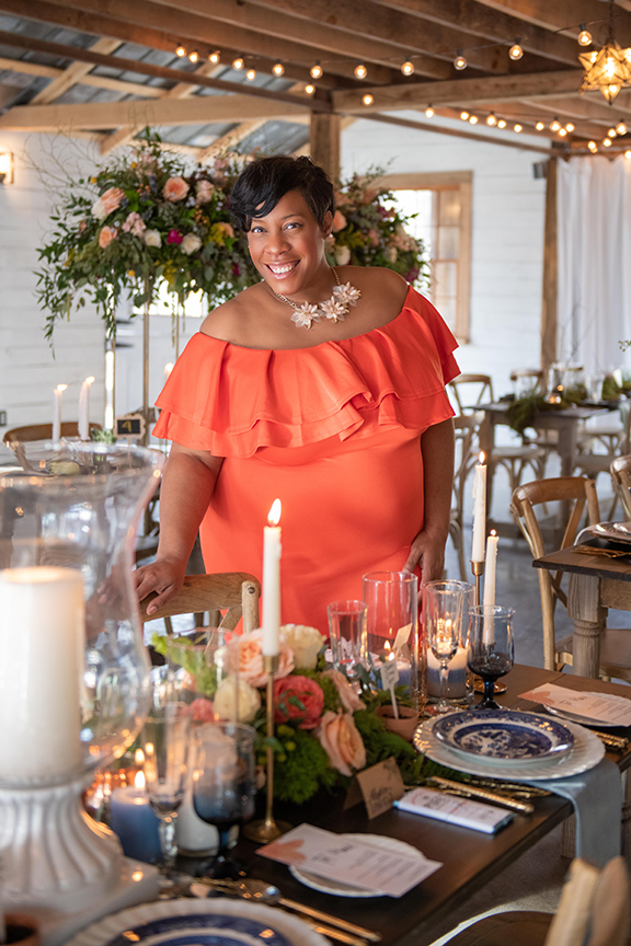 Shaun Mosley in a pretty coral dress, wedding table setting in a white barn in chattanooga tennessee
